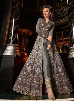 Grey All With Golden Embroidered Lehenga/Pant Suit features embroidery work with minimalist modern art detail annotated beautifully with the combination of resham zari, thread and stone work on its flared anarkali net top Indian Designer Outfits, Indian Outfits, Designer Dresses, Indian Gowns Dresses, Pakistani Dresses, Eid Dresses, Salwar Kameez, Fashion Pants, Fashion Dresses