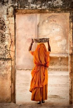 Beautiful...Practice of carrying on top of the head has existed since ancient times, & is a common practice in many parts of the world. This is an alternative to carrying a burden on the back, shoulders, and so on.
