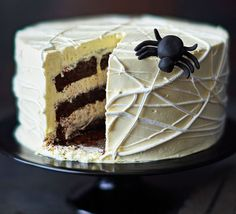 Swiss meringue buttercream icing transformed into a spooky Halloween showstopper - this rich chocolate sponge will be the guest of honour at any Halloween party