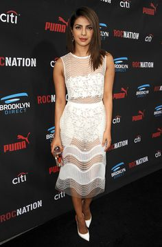 Priyanka's sheer white dress is a knockout, but her structured clutch and coordinated white pumps are just ...