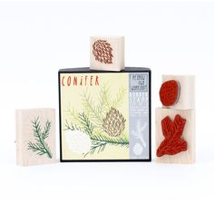 Bring a little nature into art projects with the Conifer Stamp Set. Create pine cone and and pine needle branch patterns on cards, place card, and so much more! Stamp set includes two natural rubber stamps mounted on maple blocks.