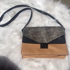 Clutch w/Cross Body Strap Tan and black leather with black and white calf-hair. 4 separate pouches with zipper and magnet enclosures. In great condition. Comes with original dust bag. Loeffler Randall Bags Crossbody Bags