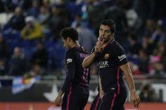 Barcelona's Uruguayan forward Luis Suarez (R) celebrates after scoring his team's third goal during the Spanish league football match RCD Espanyol vs FC Barcelona atthe Cornella-El Prat stadium in Cornella de Llobregat on April 29, 2017. / AFP PHOTO / PAU BARRENA