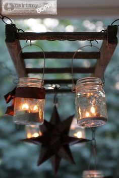 Upcycled old ladder. What a cool way to light a patio.