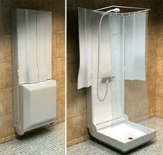 The bathroom shower folds up into just a protruding attachment on the wall when it's not in use.