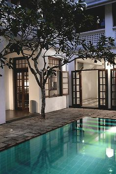 This is a great looking courtyard. I really like the color scheme (black window frames) and pool placement.