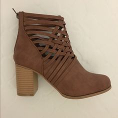 Crisscrossed tan booties New, in box tan/chestnut booties with cute crisscross design. Size 6.5 but fit like a 7. Never worn due to being too big. Shoes Ankle Boots & Booties