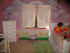 Hand painted clouds and a picket fence in my daughter's room...   I wanted to sleep in there....