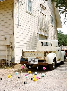 Vintage truck, old farmhouse, newly weds. Takes me back to the 50's.  I love this photo!