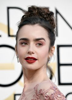 Actress Lily Collins attends the 74th Annual Golden Globe Awards at The Beverly Hilton Hotel on January 8, 2017 in Beverly Hills, California.