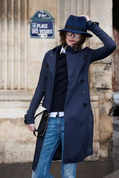 fedora hat + glasses + button-down + long sleeved top + trench coat + boyfriend jeans : androgynous, tomboy look, layering