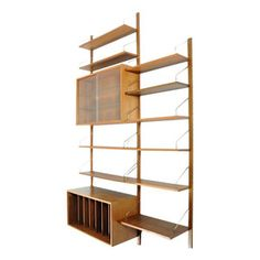 Cado wall / shelf system in teak. Designed by Poul Cadovius. Manufactured by Cado.