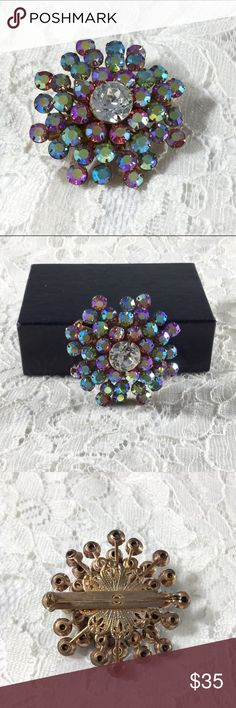Vintage Sweet Pastel AB Rhinestone Dome Brooch Gorgeous sparkling gold tone Aurora Borealis rhinestones in a dome setting.  The ABs are glittering colors of pink, yellow, green, purple, all pastel colors.  Center is a large clear rhinestone. The back is rivet construction. Vintage Jewelry Brooches