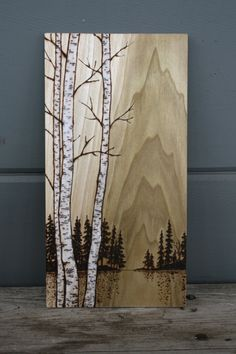 These beautiful birch trees have been burnt into a thin piece of poplar wood and finished with a touch of whitewash and oil to enhance the birch trees and the wonderful grain of the wood. The piece measures about 10 1/2 inches tall by 5 1/2 inches wide on 1/4 inch thin solid wood. It has a small hook for hanging on a wall but would also look lovely perched on a shelf amongst your favorite things! Add a touch of modern woodland charm to your home! Carefully wrapped and ready to ship.