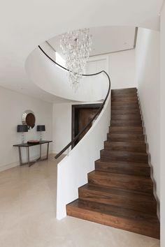 dark walnut treads + white plastered balustrade + dark handrail by Bisca