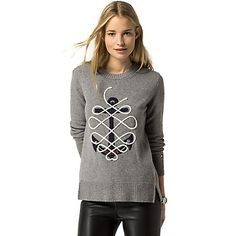 Tommy Hilfiger women's sweater. This nautical-themed sweater is ideal for the warmer months in lightweight wool with hand-knit applique. We're layering ours over summer whites and denim, the perfect palette for nautical accessories. <br>• Classic fit.<br>• 92% cotton, 8% cashmere.<br>• Split hem, custom patchwork. <br>• Hand wash or dry clean. <br>• Imported.<br>