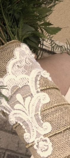 Burlap stem wrap on bridal bouquet layered with lace from the bride's mother's dress - by Becky at Krueger of Schofield