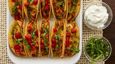 Easy Oven Baked Chicken Tacos - These cheese- and bean-stuffed tacos are our new favorite way to turn a rotisserie chicken into a super-easy dinner that serves up to Easy Oven Baked Chicken, Baked Chicken Tacos, Baked Tacos, Mexican Dishes, Mexican Food Recipes, Mexican Meals, Mexican Cheese, Mexican Cooking, Ethnic Recipes