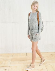 BSK short knit jumpsuit with pockets. Discover this and many more items in Bershka with new products every week
