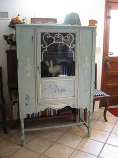 C. 1920/30 Cabinet I painted using Annie Sloan chalk paint in Duck Egg Blue and accented in Cream...See other picture for side view.