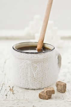Winter coffee in a knitted cup