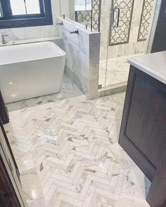 Were just finishing a special custom bathroom design and build in our local Sioux Falls community. Italian Calacatta Gold Marble & Athen Grey Waterjet Mosaic highlights the shower walls. herringbone pattern creates a walk way boarded by Tiles. Marble Bathroom Floor, Shower Floor Tile, Gold Bathroom, Bathroom Flooring, Small Bathroom, Tile Flooring, Shower Walls, Bathroom Modern, Bathroom Cabinets