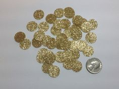 This round confetti is made using glittered cardstock that is lignin and acid free. It is glittered/colored on the front, and white on the back.