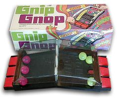 "GNIP GNOP: Bang on the red flippers to knock your colored ping-pong balls through the holes in the plastic ""net"" and get all six balls on your opponent's side. Keep in mind that this was right before Atari."