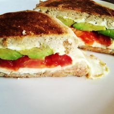 Avocado and tomatoes grilled cheese sandwiches