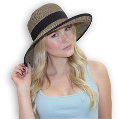 Sophisticated two-tone woven women's sun hat that is UPF 50. The classic styling elevates this hat from casual to a stylish accessory for any outdoor event.