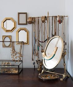 on your dresser create a nook to display your precious jewellery items - mixed in here are some black picture frames on the wall just to give the nook further depth and layering.