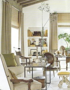 Layered window treatments, neutrals with pops of color.