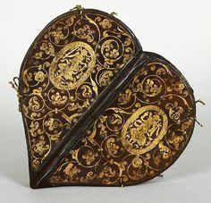 For the Love of Books...Caspar Meuser (1550-1593) was an apprentice of Jakob Krause, serving from 1574 as his successor in the court bindery. He used the panels and stamps designed by Krause, but evolved his own style, characterized by profuse vinework. This heart-shaped prayer book, designed for Anna, the wife of Elector Augustus, is a particularly fine example of his artistry. Betbüchlein ür allerlei Anliegen (Small Prayer Book for All Occasions), ca.1580.