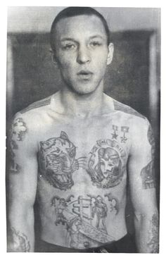 The medals tattooed on the chest are the Hero of Soviet Labour and Hero of the Soviet Union, both intended to mock the authorities. The tattoo of a tiger is a sign of agression. The coffin on the stomach represents a conviction for murder, the woman kneeling over it indicates that the crime was committed because of a woman.