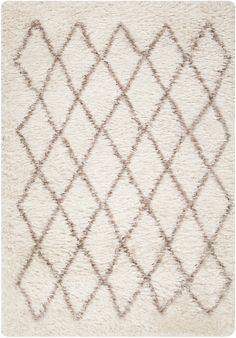 The simple diamond design and plush texture of this rug make it the perfect statement piece for your living area.
