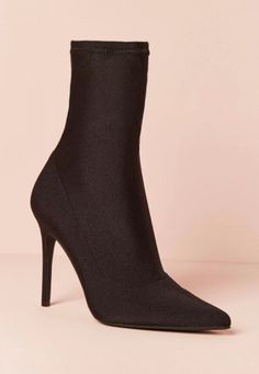b3eb03f7704f0 A pair of ankle sock boots featuring a pointed toe