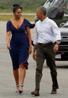 President Barack Obama with first lady Michelle Obama exit Air Force One, 8/6/16.