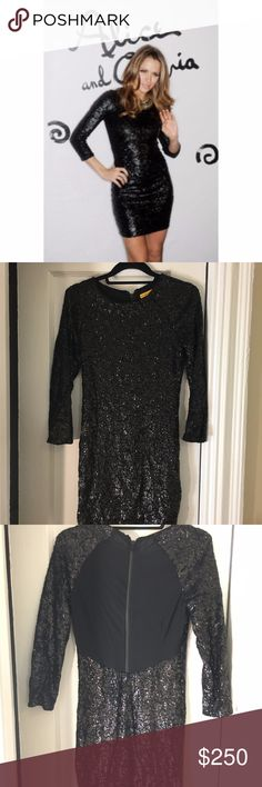 Alice and Olivia Black Sequin Mini Dress This dress has NEVER been worn! Size 8 Alice and Olivia black sequin mini dress with long sleeves. Stretchy material with a sheer back, and a zipper down the back. I think this dress would fit  a true 8 or a true 6 depending on how this brand runs on your body. Link to comparable version of the dress here…