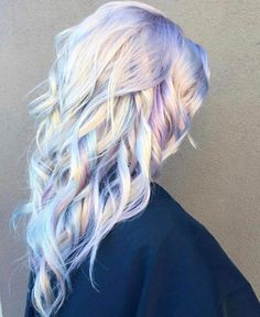 The pastel hues and shimmering undertones create a holographic appearance in the latest, and downright magical, hair trend.