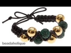 http://www.beadaholique.com/yt - In this video, learn how to make a zig zag double row Shambhala style bracelet using waxed cotton cord, 10mm round beads, and macrame knotting.    Designer: Megan Milliken    Emerald City Double Shambhala Bracelet  Project B1082  http://www.beadaholique.com/t-ba-project-B1082.aspx?utm_source=YouTube_medium=social-m...