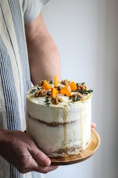 this cake is made with layers of chai and walnut sponge and its filled with persimmon stem ginger jam and it is topped with maple candied walnuts. I made the jam with three ripe persimmon and a sma…