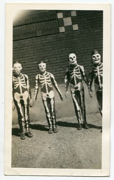 Little costumed Halloween skeletons. The addition of a fez? genius!