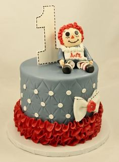 grey and red, raggedy ann