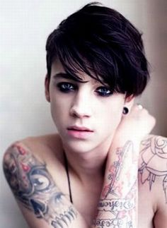 He's adorable. I don't care who he is but he has tattoos and makeup and plugs. i love him.
