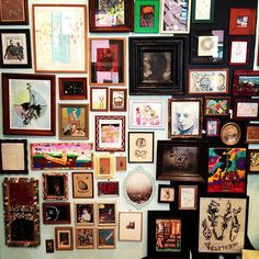 Love the idea of a frame/photo/art collage in all sizes, shapes, and colors.