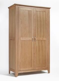 Sherwood Oak Wardrobe All Hanging is a beautiful made piece of furniture and contains lots of bedroom storage. The wardrobe has a double hanging rail behind the two doors and for extra design detail it has panel sides and chamfered leg ends.