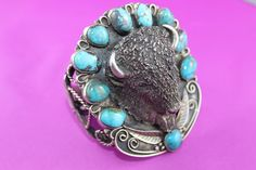 It has a large buffalo head on the center front. It is a sterling silver bracelet adorned with turquoise beads. It is a cuff style bracelet. This is a fabulous mens bracelet. I want you to be a happy winner. | eBay!
