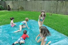 Make a WATERBLOB for your kids!  Fold 3mil plastic in half, tape 3 sides with duct tape (leave small opening for hose), fill it up, add food coloring, glitter, rubbery toys that wont tear the plastic. Spray the top with water for an awesome slip and slide. Great toddler party idea