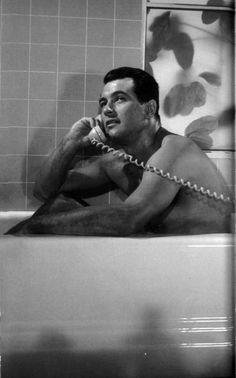 Rock Hudson in a bath tub talking on a phone