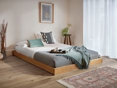 With no headboard attached, the Low Enkel Platform Bed makes the most of tight spaces. Handmade from gorgeous sustainable timber, the sleek modern design is low to the ground. Low Floor Bed, Floor Bed Frame, Diy Bed Frame, Low Platform Bed Frame, Wooden Platform Bed, Platform Bed Designs, Bed Frame Design, Wooden Bed Frames, Wood Beds